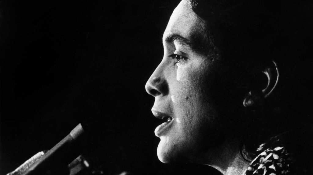 Dolores Huerta speaks at the podium. c1970s. Courtesy of Walte P. Reuther Library Archives of Labor and Urban Affairs Wayne State University
